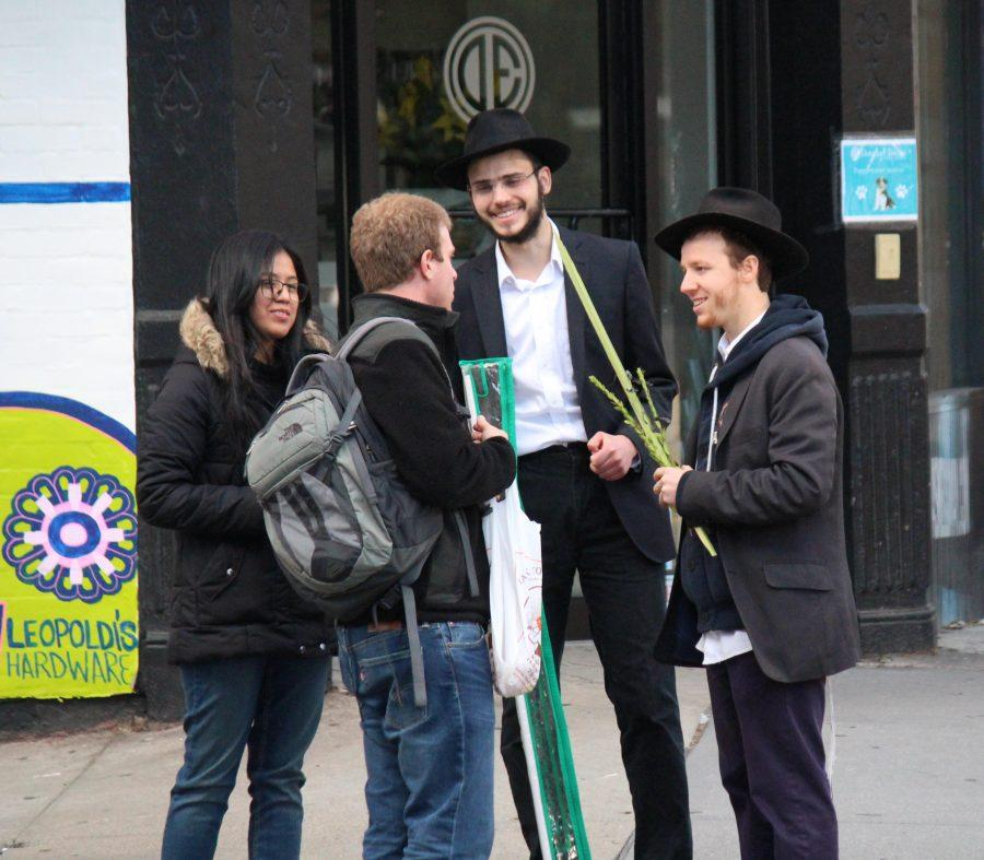 Mendy (right) and another Hasidic Jewish man talking to passers-by on 7th Avenue.