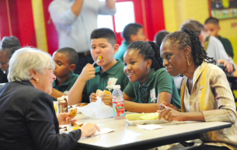 Source: Getty Images. New York City Schools Chancellor Carmen Fariña (Left) and Mayor de Blasio's wife, Chirlane McCray (Right) eat lunch with students at Journey Prep School in the Bronx where many students depend on free lunch.