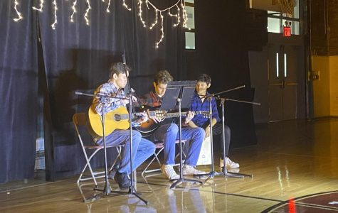 Sean C. '21, Oliver S. '21, and Antonio D. '21 performing Take Me Home, Country Roads